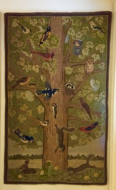 Tree with birds and animals hooked by Marjorie Gilbert Anderson. 3.5x5.5 ft