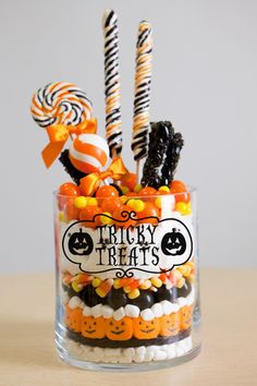 """Tricky Treats"" Halloween vinyl lettering candy jar decal ideas www.lacybella.com"
