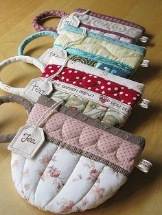Tea cup pouches - great teacher present. Mug rug to match? Fabric Crafts, Sewing Crafts, Sewing Projects, Mug Rugs, Sewing Hacks, Sewing Tips, Quilting, Tea Party, Purses And Bags