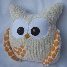 THIS IS THE LAST ONE! A chubby hoot for those who like them a little plump.     Made with pcreamy chenille. The Amy Butler fabric on the inside of the wings and the little appliqued heart on the belly make this owl extra cute. THe white part of the eye is muslin the brown part is wool felt.  Safe for the little ones.    Measures about 7.5 wide by 7.5 tall.    Thank you so mush for looking!    Please view my other items at  aprilfoss.etsy.com
