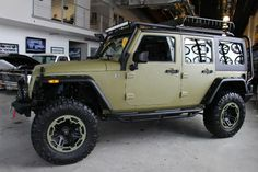 2014 ARMY GREEN JEEP WRANGLER UNLIMITED SPORT WITH 2.5″ LIFT AND 35″ TIRES – $63,995 | American Wheel and Tire