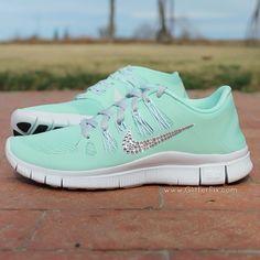 "Brand new customized pair of ""Customized NikeiD"" Nike Free 5.0 adorned with Swarovski rhinestones in a mint green."
