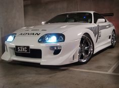 1994 Toyota Supra  tri-slot hood does not suit the bulky body, but i guess the rims made up for it.