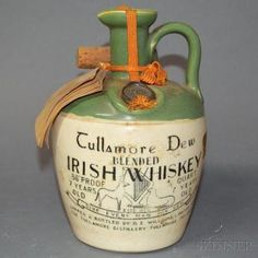 A Ceramic Crock Of Tullamore Dew S 12 Year Old Whisky From