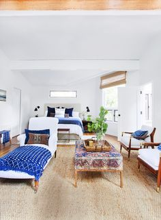 """""""Have a big bedroom?"""" says Lewis. """"Transform the extra space into a seating area."""" Lewis used a vintage carpet and a sleek metal base to give new life to a thrift-store ottoman, which doubles as an eye-catching coffee table.  - GoodHousekeeping.com"""
