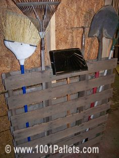 Pallet Garden tools holder.  This is DEFINITELY something we need to do in our garage!!