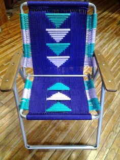 Geometric design colors are teal and lavendar triangles on purple  SOLD