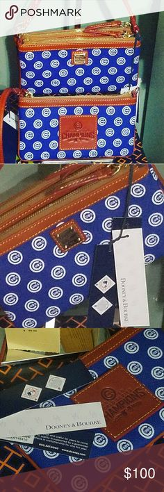 Go Cubs Go* Authentic Dooney & Bourke Chicago Cubs RARE**SOLD OUT**2016 Champions**  Dooney & Bourke MLB Chicago Cubs Leather Wristlet*Large 2016 World Championship Patch on back.   Comes with all paperwork to register with dooney. Dooney & Bourke Bags Clutches & Wristlets