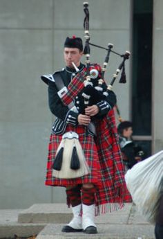 Oooo that's a great kilt. Love the red and black uniform. And the bagpipes.  from yourkilt.com