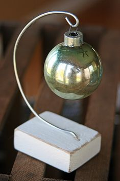Mamie Jane's: Ornament Hanger Easy to make with wire and a wood block.