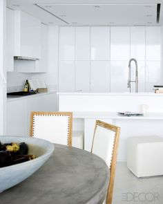 Darryl Carter - Modern Condo Design for his parents in Bal Harbor, FL  - The kitchen cabinetry is by SieMatic, the counter-tops are quartz.