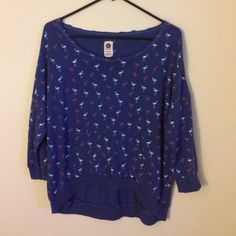 Roxy flamingo sweater Searched for this for a year!!! Sad to see it go but I never wear it. Slightly oversized sweater, navy blue with white and pink flamingos. Dimensions: full length (front): 22, full length (back): 25in, waist: 20in. Has a kangaroo front pocket and 3/4 sleeves. Please use the offer button if interested. Sorry I do not hold or TRADE Roxy Sweaters