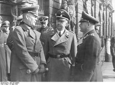Wilhelm Keitel, Heinrich Himmler, and Erhard Milch awaiting before the armory for Adolf Hitler's arrival for the Memorial Day celebration, Berlin, Germany,  March 14, 1942