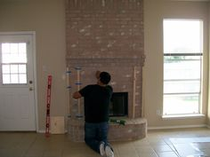 Do you have a fireplace that is an outdated eyesore?  Here is how we updated ours without removing a single brick. Before   Before (realtor...