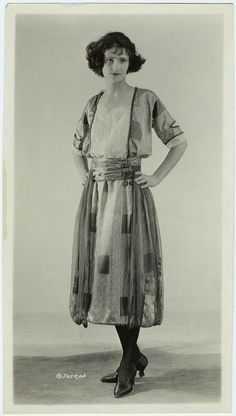 [Woman in striped dress, ca. 1921.]