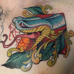 Awesome colorful neo-traditional  snake piece by Broc Chitty.  Chest piece, colorful tattoos, art, body art, tattoo inspiration.