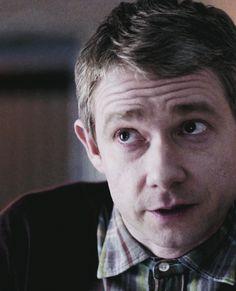 Martin Freeman as John Watson. ;) I love how he buttons the top button of his shirt --- nerdy but cute.