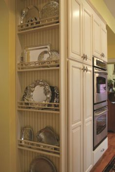 This plate rack keeps platters near the ovens and island but doesn't get in the way of the kitchen's everyday work zones. - david lyles developers