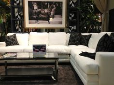 Exquisite equestrian. Black and white is always a classy look! #living_room #sectional #for_the_home | Houston TX | Gallery Furniture |