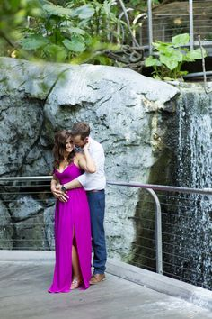 Engagement session at the San Diego Zoo in Balboa Park, Couple in front of a waterfall in an atrium at the zoo, Cavin Elizabeth Photography