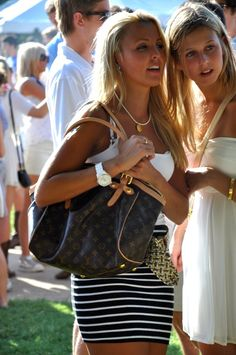 tank and form fitting skirt with bold jewelry. and love the bag....