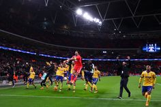 Juventus players celebrate at the end of the UEFA Champions League Round of 16 Second Leg match between Tottenham Hotspur and Juventus at Wembley Stadium on March 7, 2018 in London, United Kingdom. - 130 of 146