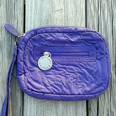 Cute Lightweight Purple Clutch Really cute! Cloth material. Has main zipper compartment plus small zipper inside and additional outside zipper compartment. There is a stitch pattern on purse. Tiny area near zipper has some pen marks but truly not noticeable. Measures about 7.5 inches across 6.5 inches in height. New York & Company Bags Clutches & Wristlets