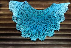 Crescent top down shawl with star shape adorning the nape. Beads scattered through glisten like drops of water.