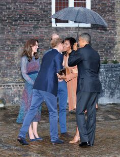 Barack and Michelle Obama are greeted by Prince Harry, Prince William, and Kate Middleton.
