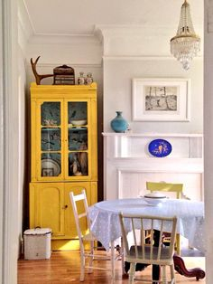 Gorgeous victorian cabinet painted with Annie Sloan Chalk Paint®  in color English Yellow finished with clear wax and Provence  with bird decoupaged interior. Chairs painted in English Yellow/dash of Antibes Green, Old White, and Versailles from Find of Temple Bar, Dublin www.findonline.ie