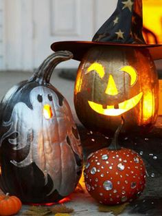 Glammed up painted pumpkins with gems, sequins and glitter glue. #halloween