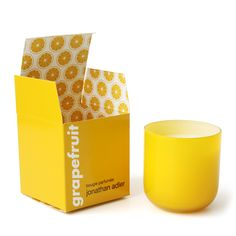Grapefruit Pop Jonathan Adler Candle | Crisp and clean. Garden scents in a bold pop glass vessel with packaging as fresh as the product. Grapefruit is a blend of pink grapefruit, white grapefruit rind, green vine accords, pink freesia, and passion fruit.