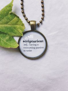 scripturient  (adj.) having a  consuming passion  to write      Details:  -one pendant featuring pictured definition  -24 ball chain This necklace