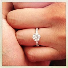 love this!!  micro pave band with solitaire center stone!