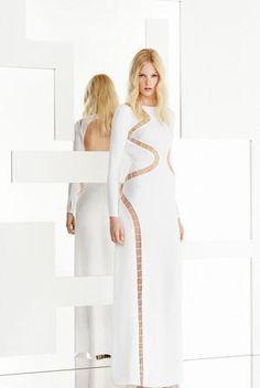 Chrissy Teigen wearing Emilio Pucci Resort 2015 Cut Out Longsleeve Gown