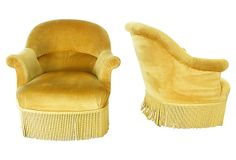Pair of antique French Napoleon III-style armchairs with original gold velvet upholstery and fringe.