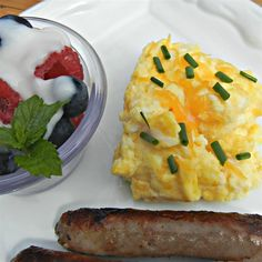 Cheesy Oven Scrambled Eggs | Light, fluffy scrambled eggs are perfect for a breakfast or brunch crowd! I serve them with my cranberry-orange almond scones and get rave reviews!