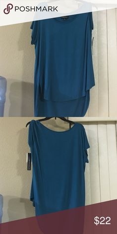 New with tags top Turquoise short sleeve top short in front long in back top Tops Blouses