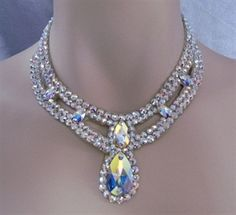 This Pear drop necklace is created with Crystallized™ Swarovski Elements Aurora Borealis crystals. One of our most popular necklaces, this will work with almost all dress necklines. It has been copied