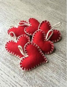 Look Over This Handmade red felt heart with contrasting white blanket stitch, hung on plaited cotton. Perfect for creating a traditional, vintage or Scandi Christmas style. The post Handmade red fel . Felt Christmas Decorations, Felt Christmas Ornaments, Heart Decorations, Valentine Decorations, Valentine Day Crafts, Holiday Crafts, Valentines, Scandinavian Christmas Decorations, Diy Ornaments