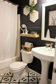 Bathroom Decor Small Bathroom Remodel Reveal This small guest bathroom got a big update on a tight budget. With dark moody walls, loads of texture, and eclectic modern accents, this remodel is a must-see. Diy Bathroom, Small Room Design, Bathroom Trends, Guest Bathroom, Small Bathroom Decor, Guest Bathroom Small, Modern Bathroom, Amazing Bathrooms, Bathroom Decor