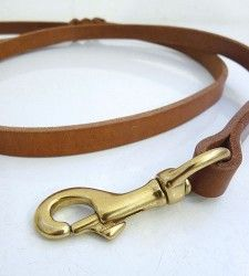 "Leather Dog Leash.  A handmade, natural vegetable tanned leather dog leash with braided hand loop, brass screw posts, and a solid brass bolt snap. Made from extra durable, hand beveled and oiled USA cow hides.     Choose from 4' x .5"" or 6' x .75""    Made in the USA."