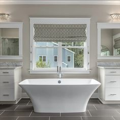 Luxury en suite bath with a free-standing tub, tile flooring, dual sinks and vanities, and a glass-enclosed rain shower. Listed in Vienna, Virginia for $1.399M by The Casey Samson Team is a Wall Street Journal Top Team in Northern Virginia.