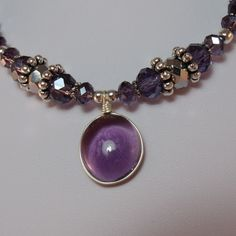 Amethyst and silver pendant handmade necklace. interested that so many different textures flow together.