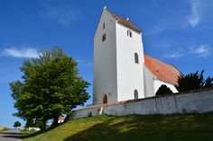 Møn island in Denmark - church with whitewashed tower - one theory is that these medieval church towers were so high and white, in order they could be used as a landmark by sailors on the Baltic Sea coast.