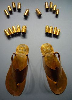 Ancient Egyptian gold sandals, toe and finger stalls. Gold Dynasty 18, reign of Thutmose lll ca. 1479-1425 B.C. From the tomb of the three minor wives of Thutmose lll in the Wady Gabbanat el-Qurud, Thebes