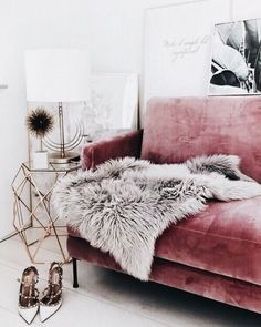 Blush velvet couch and faux fur rug