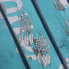 << Dreamcatcher Turquoise Feather Earrings >> The cute little earrings are a perfect accessory! Silver tone with turquoise stone.  Nwt from my boutique  2 available Boutique  Jewelry Bracelets