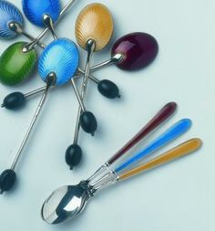 A colourful set of enamelled vintage silver teaspoons or coffee-bean spoons from The London Silver Vaults.