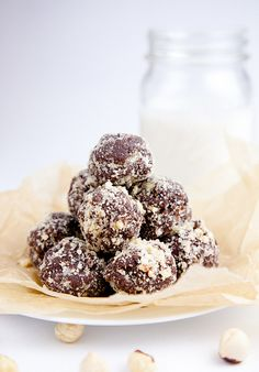 Nutella Cookie Dough Balls	  makes about 14 balls  2/3 C. Raw Hazelnuts, plus an additional 1/4 C. for coating  1 C. Pitted & Chopped Medjool Dates  1/3 C. Gluten-Free Rolled Oats (or regular rolled oats)  3 Tbs. Cocoa Powder  1 1/2 Tsp. Vanilla Extract  1/4 Tsp. Sea Salt